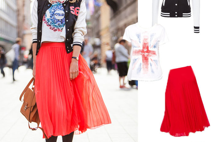 Streetstyle photo of girl in red midi skirt with varsity bomber jacket and printed t-shirt