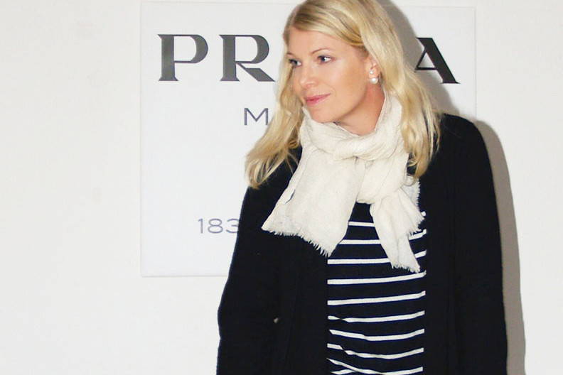 Prada Marfa wall art, striped knit and J Brand jeans on blogger Annika Soulcityguide