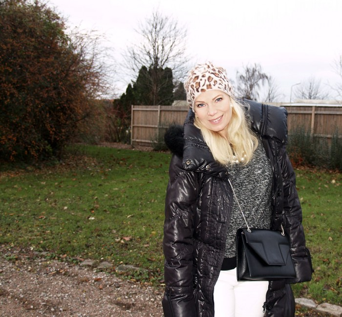 Leopard beani and down jacket with a designer bag from Saint Laurent