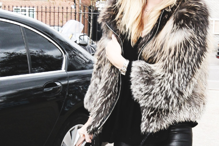 Rosie Huntington-Whiteley in a fur jacket, leather pants and a hat