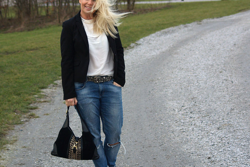 Embroidered white blouse with a black blazer and boyfriend jeans