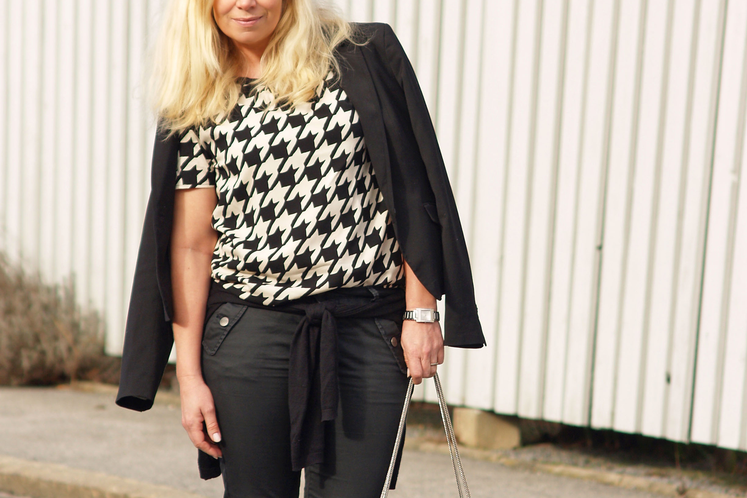 Black and beige blouse from Six Ames and a Betty bag from Saint Laurent
