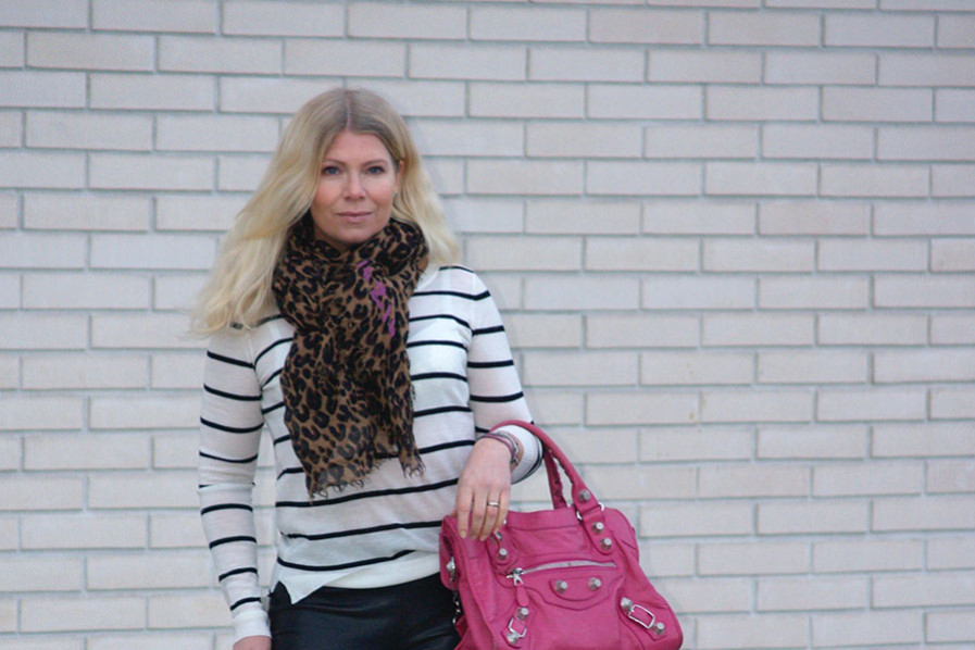 Louis Vuitton leopard scarf, six ames striped knit, pink Balenciaga Giant City
