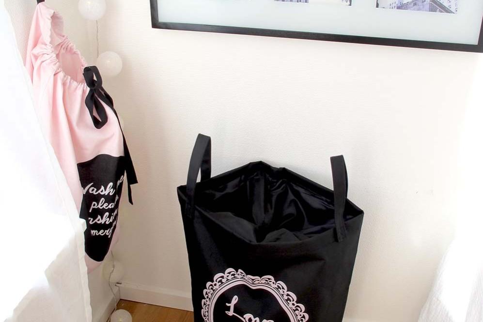 tvättkorg och tvättpåse från HM i svart och rosa